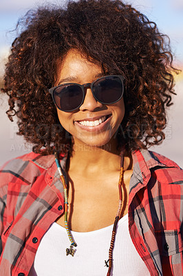 Buy stock photo A cropped portrait of a trendy young woman wearing sunglasses