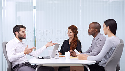 Buy stock photo A group of coworkers having a discussion in a meeting