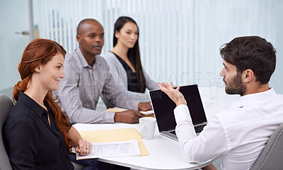 Buy stock photo A group of coworkers sitting in an office having a meeting