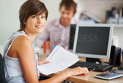 Buy stock photo Young business woman holding document and sitting in front of computer