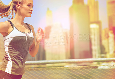 Buy stock photo Shot of an attractive blonde woman out for a run in the city