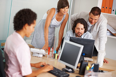 Buy stock photo Business people working on computer in the office