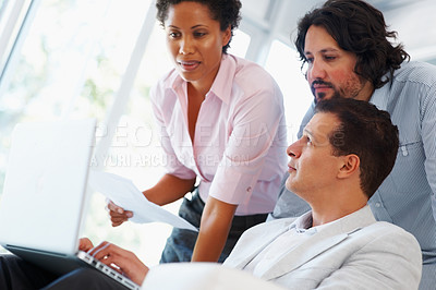 Buy stock photo Young woman with her team working on laptop