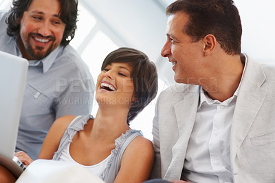 Buy stock photo Beautiful female executive with team working on laptop