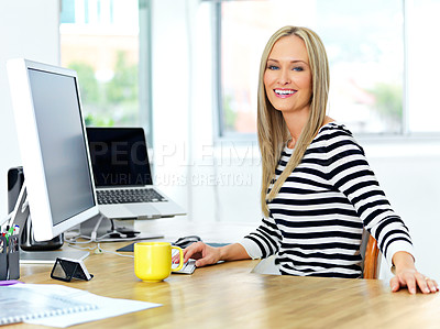 Buy stock photo Shot of a beautiful young woman working at her office desk