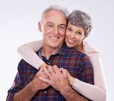 Buy stock photo Studio portrait of an affectionate elderly couple against a white background