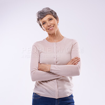 Buy stock photo Studio portrait of a happy mature woman against a white background