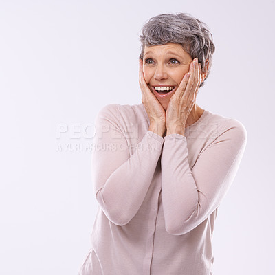 Buy stock photo Studio shot of a mature woman looking surprised against a white background