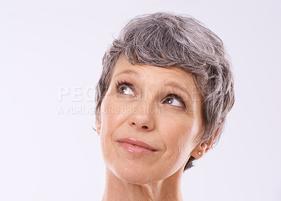 Buy stock photo Cropped studio shot of a thoughtful mature woman against a white background