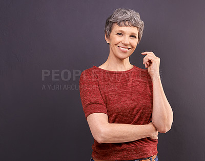 Buy stock photo Studio portrait of a confident elderly woman against a gray background