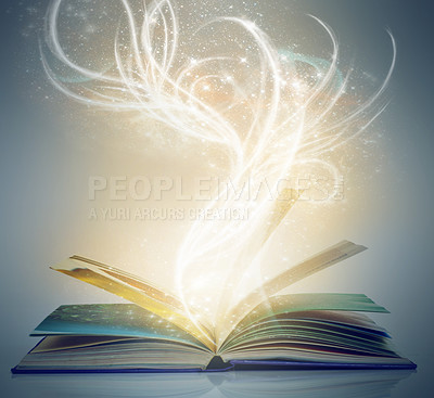 Buy stock photo A book on an isolated background with a bright,magical glow emanating from it
