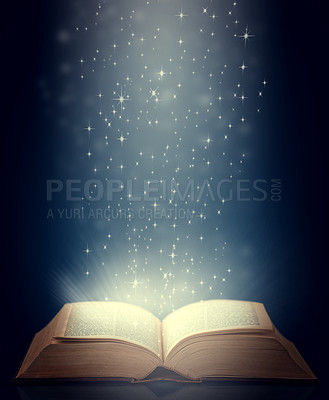 Buy stock photo Shot of an open storybook with light emanating from it