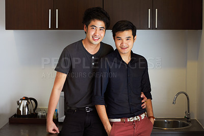 Buy stock photo Portrait of an affectionate young gay couple in their home
