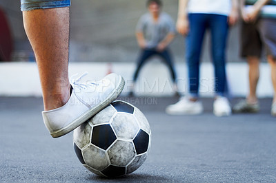 Buy stock photo Cropped image of a foot resting on a soccer ball while a defender stands in the background
