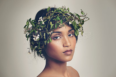 Buy stock photo Studio portrait of a beautiful young woman wearing a head wreath