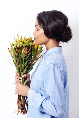 Buy stock photo Studio shot of an attractive young ethnic woman holding a bouquet of flowers