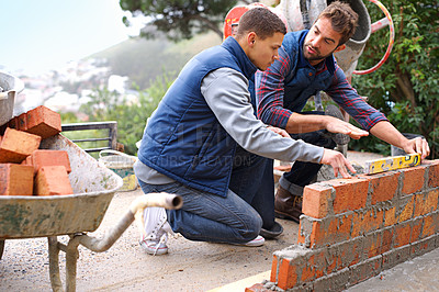Buy stock photo Shot of bricklayers at work