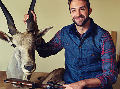 Buy stock photo Portrait of a hunter displaying one of his trophies