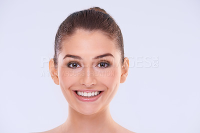 Buy stock photo Studio portrait of an attractive young woman with beautiful skin