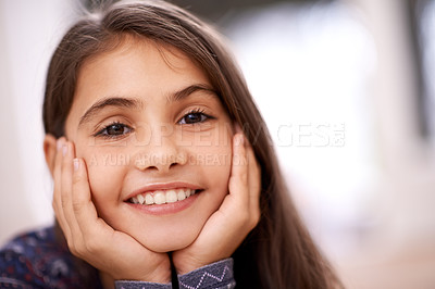 Buy stock photo Portrait of a cute little girl enjoying a day at home