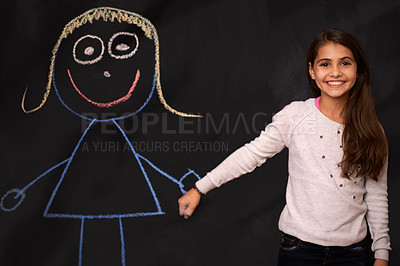 Buy stock photo Portrait of a little girl standing in front of a chalkboard drawing