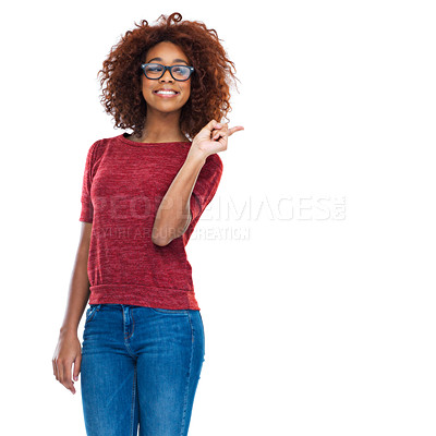 Buy stock photo Cropped studio shot of a beautiful young woman pointing at copyspace