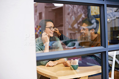 Buy stock photo Cropped shot of a young couple sitting in a coffee shop on a date