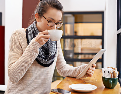 Buy stock photo Cropped shot of an attractive young woman surfing the net in a coffee shop