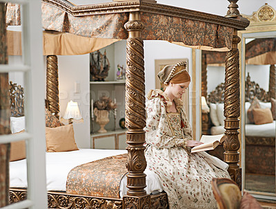 Buy stock photo Shot of an elegant noble woman reading in her palace room