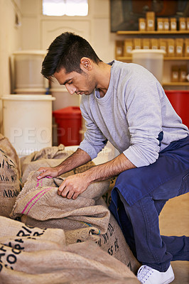 Buy stock photo Shot of a man looking at raw coffee beans