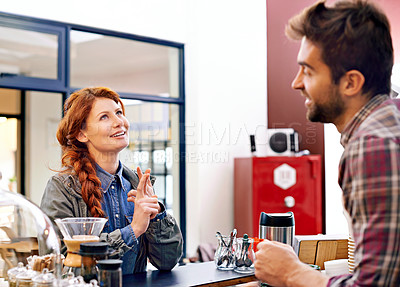 Buy stock photo Shot of a customer choosing what to order at a coffee shop