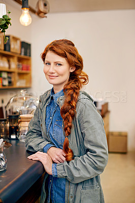 Buy stock photo Shot of an attractive young woman in a coffee shop
