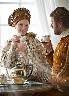 Buy stock photo A king and queen taking tea together at home