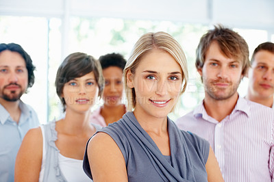 Buy stock photo Confident business woman with her supporting team in background