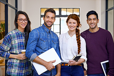 Buy stock photo Cropped shot of four young designers standing in their office
