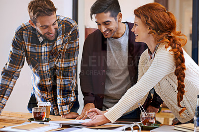 Buy stock photo Shot of a team of young designers working together in their office
