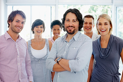 Buy stock photo Confident male leader with his successful team
