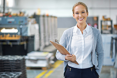 Buy stock photo A young manager looking confident while on the factory floor