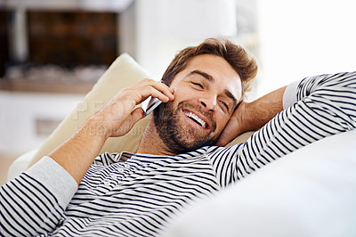 Buy stock photo Man talking on his cellphone at home