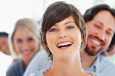 Buy stock photo Closeup of beautiful young business woman with blur team in background