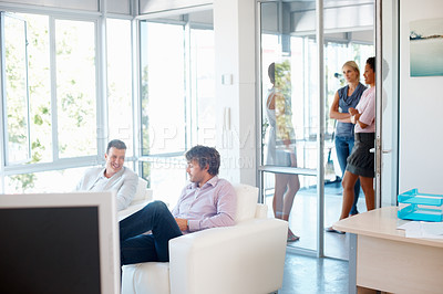Buy stock photo Businesspeople relaxing during their lunch break