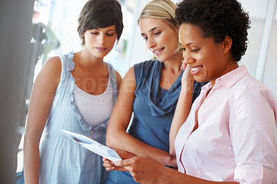 Buy stock photo African American business woman reading document with her female associates