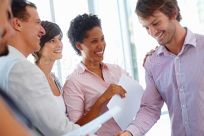 Buy stock photo Young business man shaking hands with his team