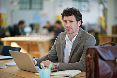 Buy stock photo Portrait of a man working on a laptop in a large office