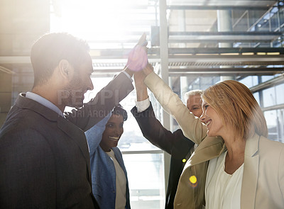 Buy stock photo Cropped shot of a diverse group of business professionals giving each other a high-five