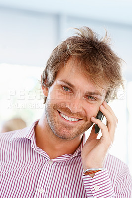 Buy stock photo Closeup of smart young man talking on cell phone