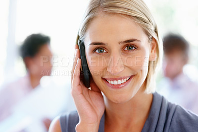 Buy stock photo Closeup of young woman using cell phone with staff in background