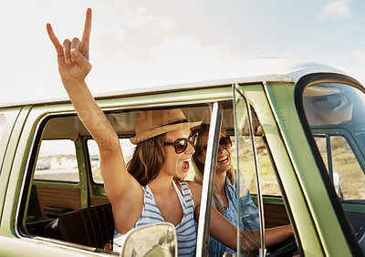 Buy stock photo Two young female friends on an adventurous roadtrip