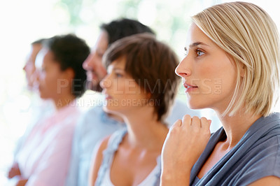 Buy stock photo Closeup of young woman with team listening to presentation at office