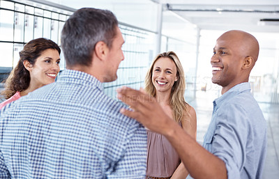 Buy stock photo A group of office workers standing together having a conversation